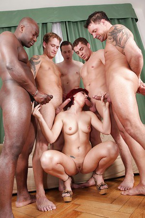 Jizz-starving redhead slut Lucy Bell gets gang banged by well-hung lads