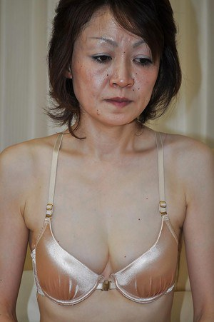 Shy mature asian lady Takako Kumagaya undressing and spreading her legs