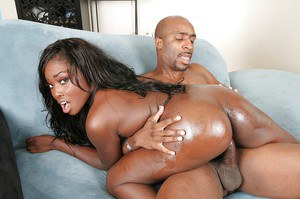 Ebony slut fucks a big black boner for a creamy cumshot on her smiley face