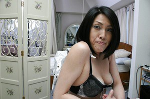 Shy asian MILF with saggy titties Miki Ohnuma getting naked