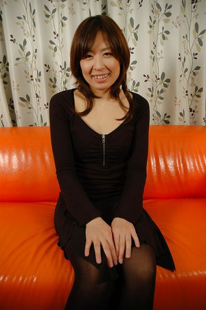 Smiley asian MILF Harumi Yoshie undressing and rubbing her hairy slit