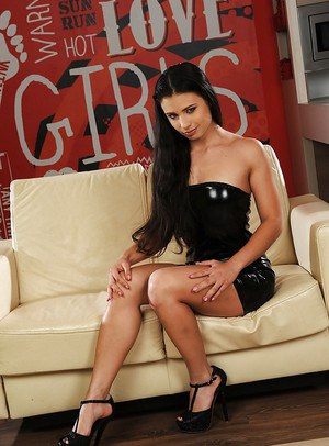 Sassy brunette chick with tiny tits getting rid of her latex dress and panties
