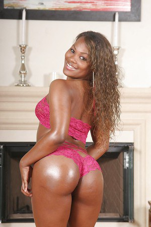 Oiled up ebony hottie Megan Pryce gets rid of her sexy pink lingerie
