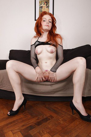 Nylon clad redhead babe Barbara Babeurre revealing her titties and hairy gash