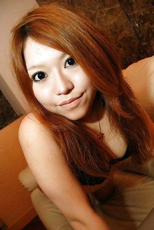 Asian teen Chiaki Eguchi undressing and exposing her hairy gash in close up