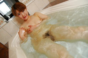 Asian MILF with ample ass Kyoko Nakano taking shower and bath