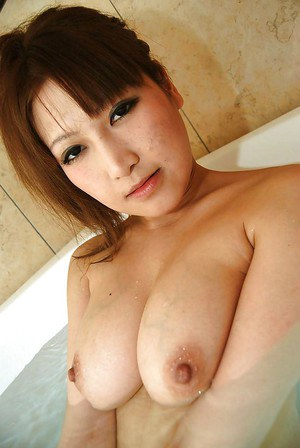 Seductive asian babe with ample bosoms Orie Okano taking bath