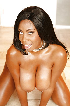 Curvy ebony lassie taking off her lingerie and demonstrating her goods