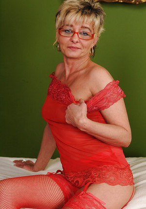 Naughty granny in glasses taking off her lingerie and spreading her legs