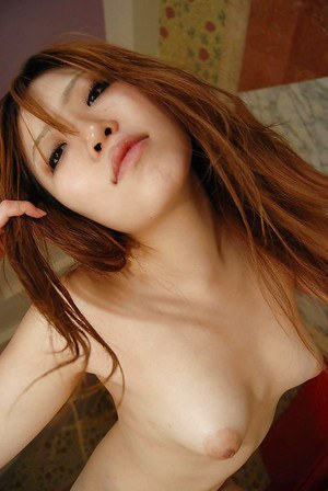 Asian hottie Minami Kubo strips down and exposes her hairy twat