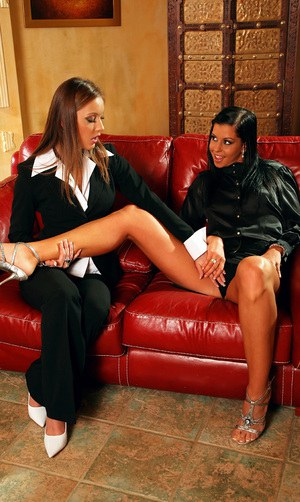 Tanned brunette enjoys clothed foot fetish action with her lesbian friend