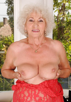 Smiley granny uncovering her chubby body and spreading her legs