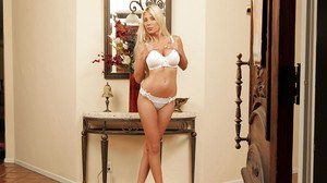 Gorgeous lingerie clad MILF undressing and playing with a glass dildo