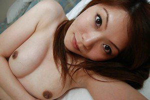 Pretty asian babe Natsuko Miyamoto toying her hairy slit after shower