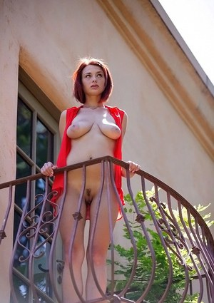 Redhead sweetie with amazing ample breasts performs a posing scene