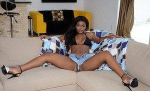 Smiley ebony knockout has no panties under her daisy duck shorts
