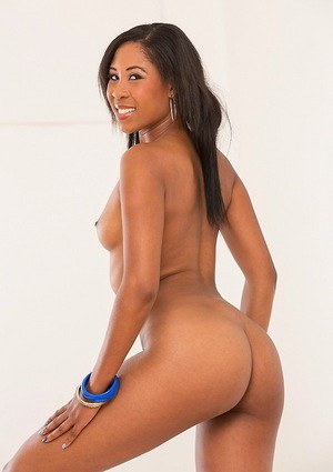 Smiley ebony chick Lola Larue undressing and showcasing her ample ass