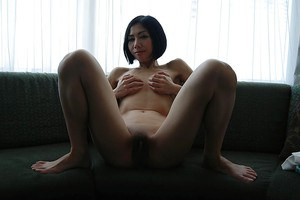 Slim asian MILF undressing and demonstrating her juicy cunt in close up