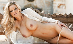 Amazingly sexy blonde babe Jami Ferrell posing barely clothed outdoor