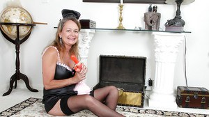 Frisky mature maid in sexy uniform pleasing her cunt with a vibrator
