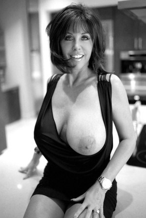 Desirable mature brunette revealing her cunt and massive knockers