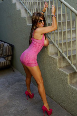 Mature lassie in provocative pink dress uncovering her big bosoms
