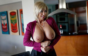 Frisky mature blonde in pantyhose revealing her big shapely breasts