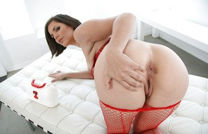 Tempting nurse in red stockings gets rid of her uniform and exposes her goods