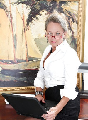 Mature lady in glasses and dress clothes revealing her tits and pussy