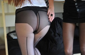 Naughty schoolgirls in pantyhose undressing and caressing each other