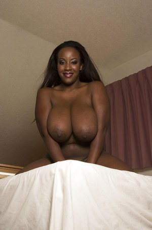 Frisky ebony MILF with boobacious tatas Sierra Lewis playing with a vibrator