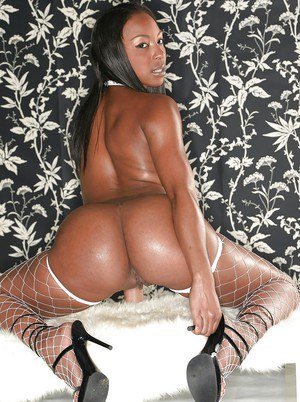 Bootylicious ebony chick in fishnet stockings gets rid of her clothes
