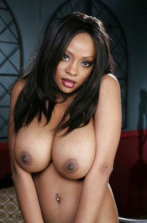 Top-heavy ebony babe Sydney Simone undressing and licking her nipples