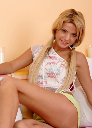 Playful european blondie undressing and teasing her slit on the bed