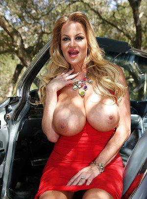Playful MILF Kelly Madison uncovering her huge melons outdoor