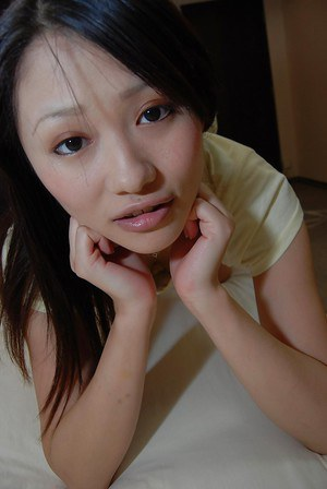 Asian teen Maki Miyauchi undressing and exposing her shaved cunt in close up