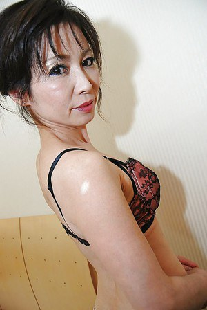 Asian MILF in pantyhose undressing and exposing her shaggy twat