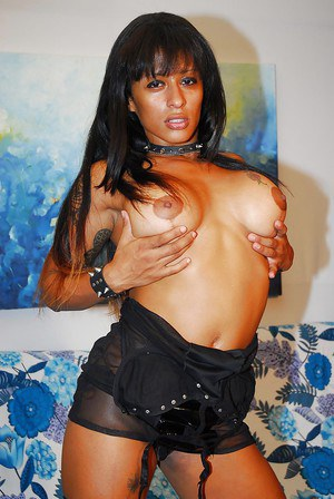 Curvy ebony lassie in snazzy outfit undressing and exposing her goods