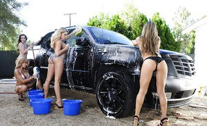 Hot ladies make some sexy car washing action ending up with a reverse gangbang