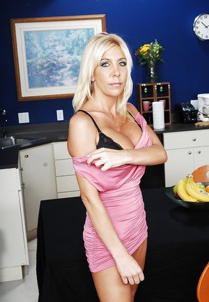 Voluptuous blonde MILF Misty Vonage stripping and spreading her legs