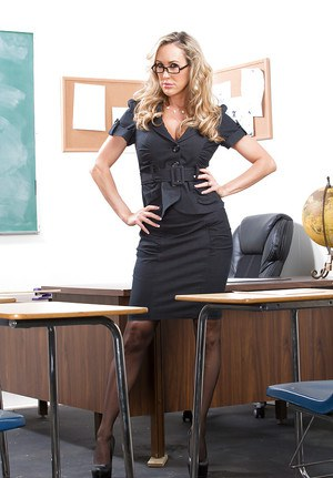 Sexy teacher in glasses Brandi Love getting nude in the classroom
