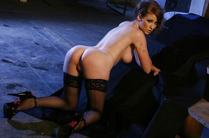 Kicky babe in stockings Nikki Rhodes uncovering her stunning curves