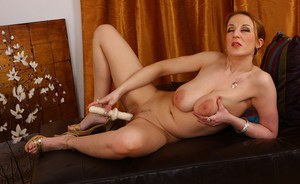 Cock-hungry mature brunette with massive jugs playing with a big dildo