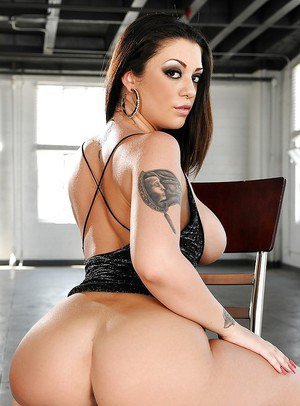 Tattooed brunette doxy revealing her massive bosoms and ample booty