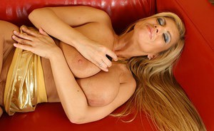 Horny mature blonde with big saggy tits playing with a gold vibrator