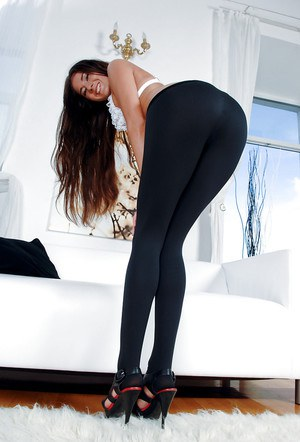 Foxy cutie in yoga pants strips down and has some anal toying fun
