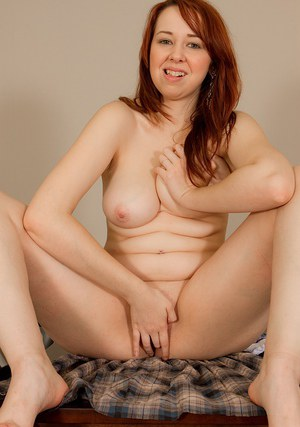 Fuckable redhead amateur with chubby curves undressing and exposing her twat