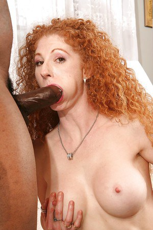 Redhead svelte MILF with hairy twat gobbles and fucks a huge black tool