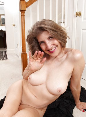 Smiley mature lady in cosplay outfit undressing and teasing her gash
