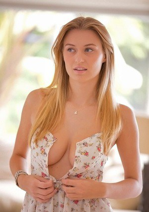 Shy blonde babe Natalia Starr slowly uncovering her voluptuous curves